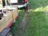 hauling plants in a muddy field